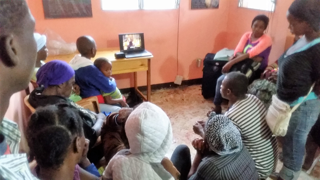 Showing the Jesus Film to the people who sought shelter in my home.