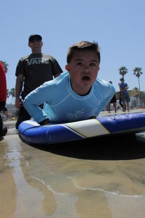 t_on_surfboard.jpg