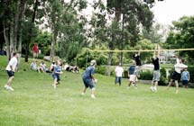 A volleyball game at a men's bar-b-q event