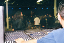 Working the audio mixer board during one of the Rock's many weekend worship services