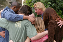 Pastor John praying with some folks after an Easter Sunday altar call