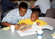 A mentor helping a child with his homework